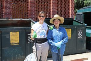 owrr move-in staff in front of dumpsters