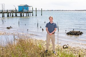 Michael Piehler stands at the site of a shoreline restoration project